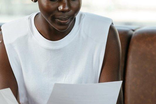 woman reading paper - thumbnail.jpeg